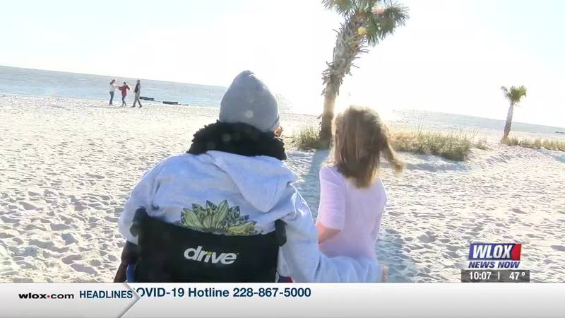 Sitting on the newly established Biloxi boardwalk, a young woman gathered with her family. Her...