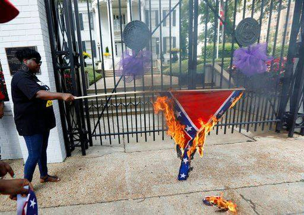(AP Photo/Rogelio V. Solis). Members of the Mississippi Poor People's Campaign burn a...