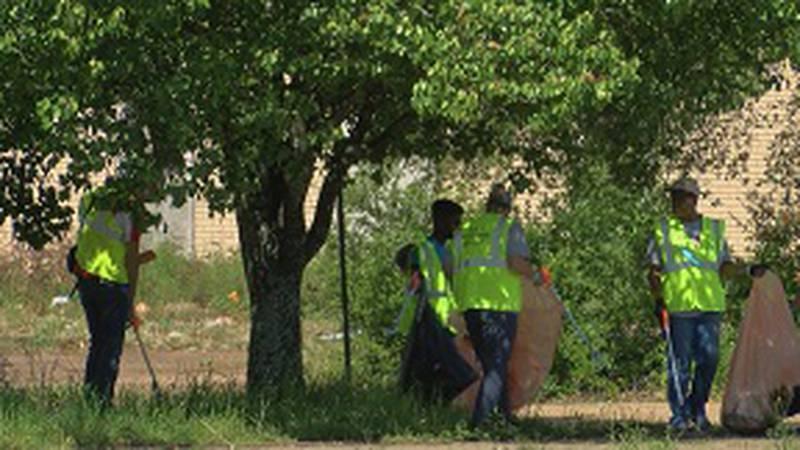 Volunteers worked on seven different sites around Jackson Thursday.