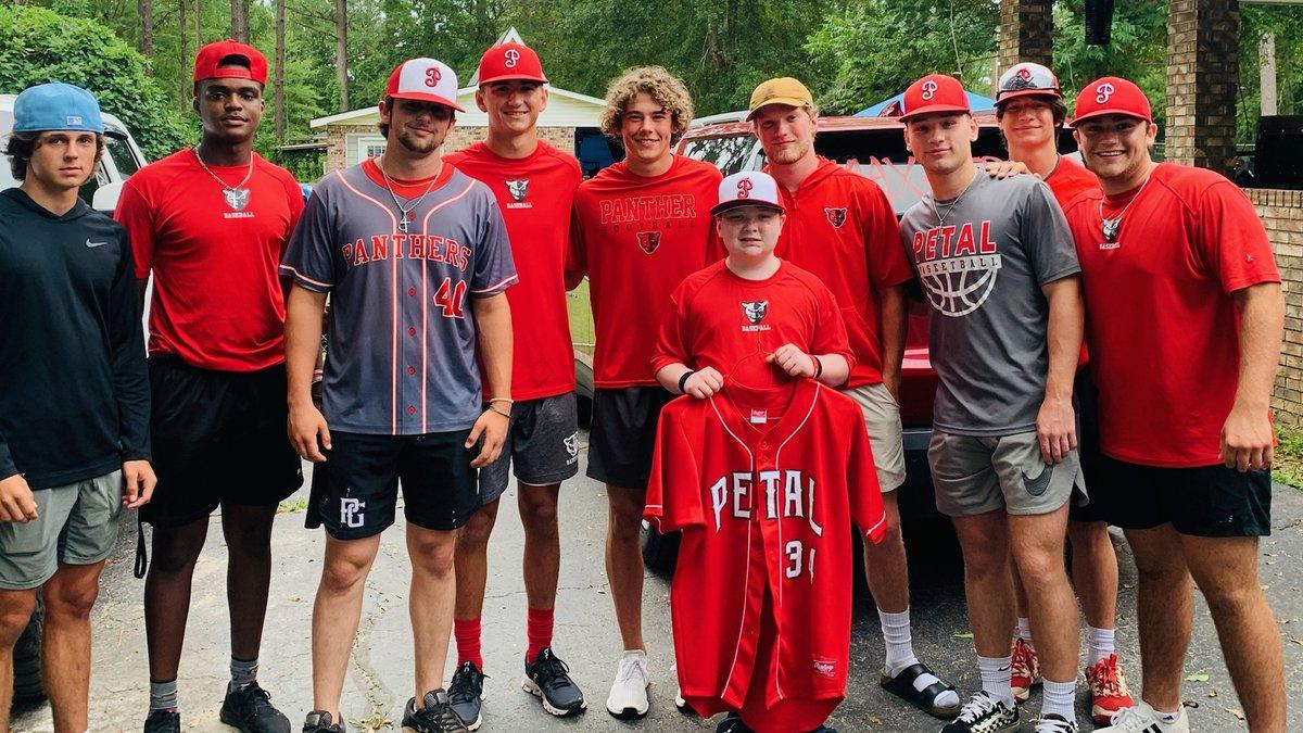 Members of the Petal baseball team and Max Fullen.