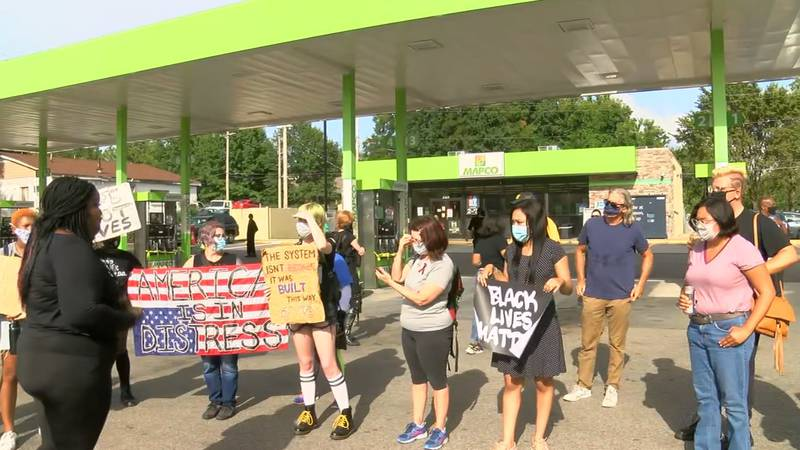 Protesters gather on Elvis Presley Boulevard where a teenager was shot by a U.S. marshals task...
