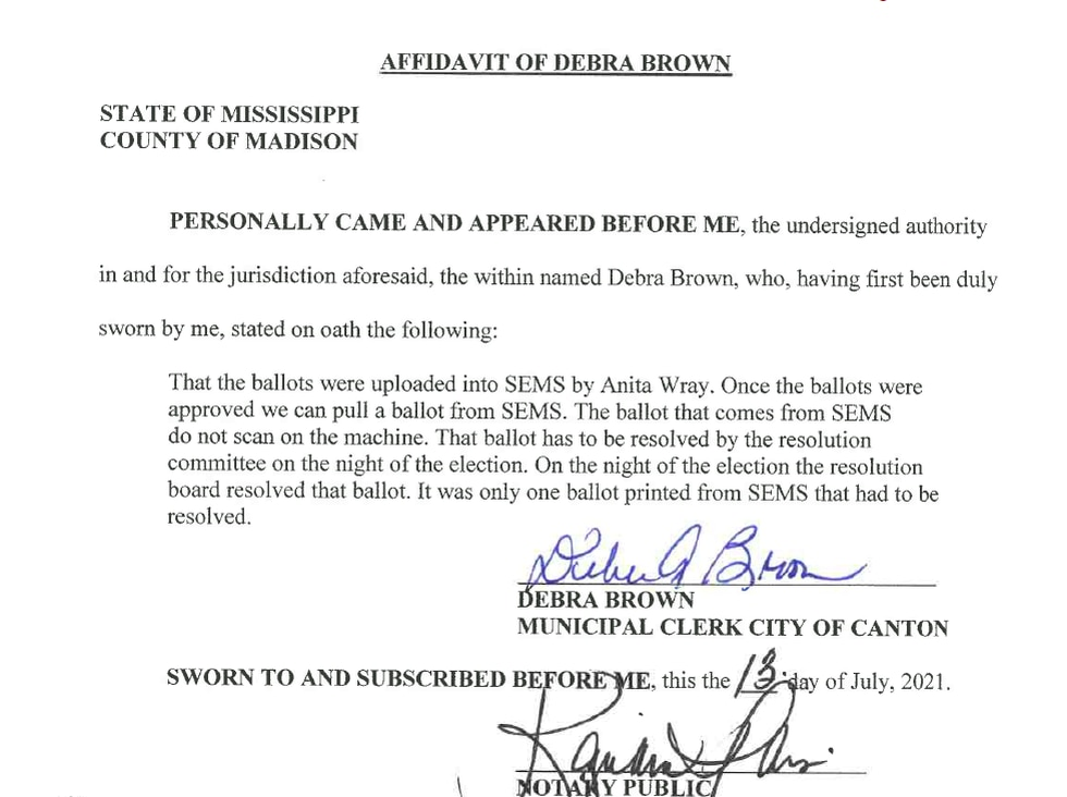 Debra Brown signs an affidavit saying why there were two ballots in the general election.