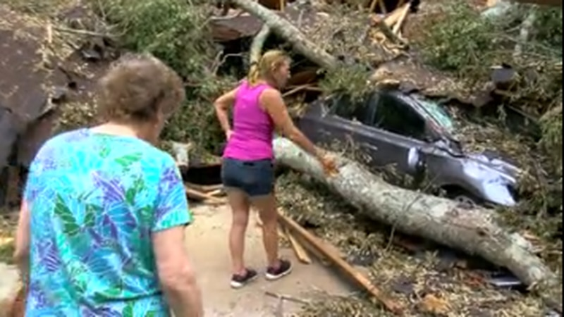 Betty Quin and her daughter, Deborah Sauls, survey damage to their McComb home.