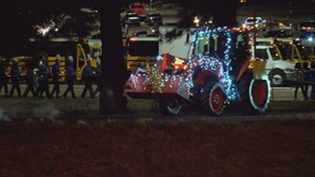 Christmas carols, children bundled up along the route and vehicles of all kinds make up the...