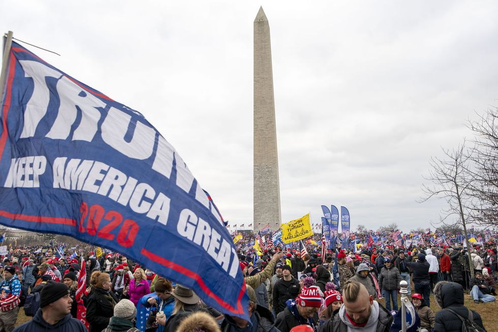 With the Washington Monument in the background, people attend a rally in support of President...