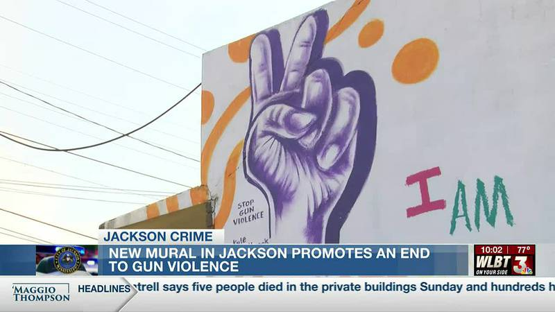 International artist paints mural in downtown Jackson that calls for an end to gun violence