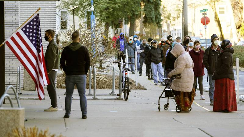 Voters wait  to cast their votes on Election Day, Tuesday, Nov. 3, 2020, at the Minneapolis...