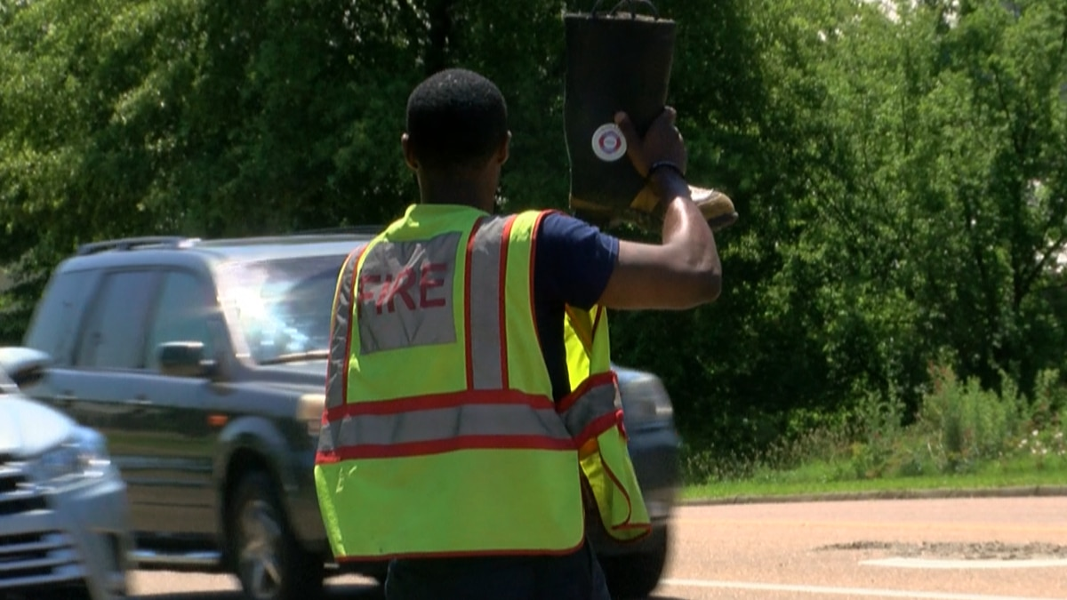 A Jackson firefighter collects money for MDA in local intersections