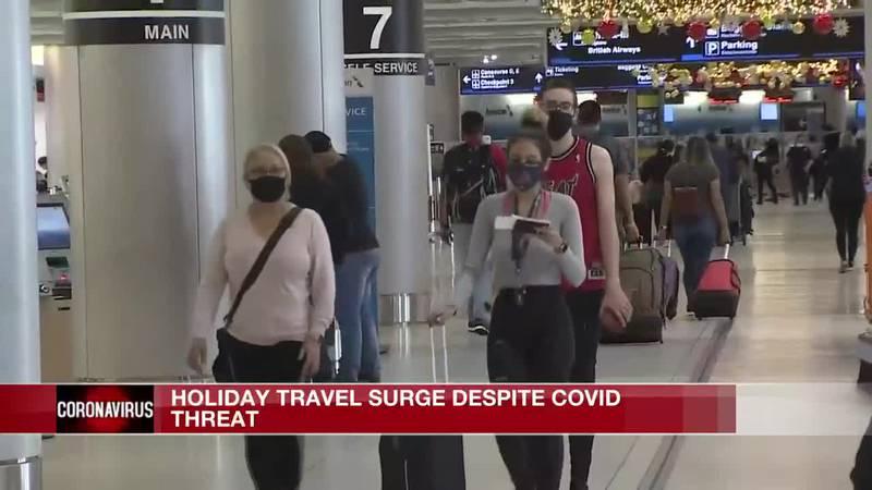 Holiday travel surge despite COVID threat