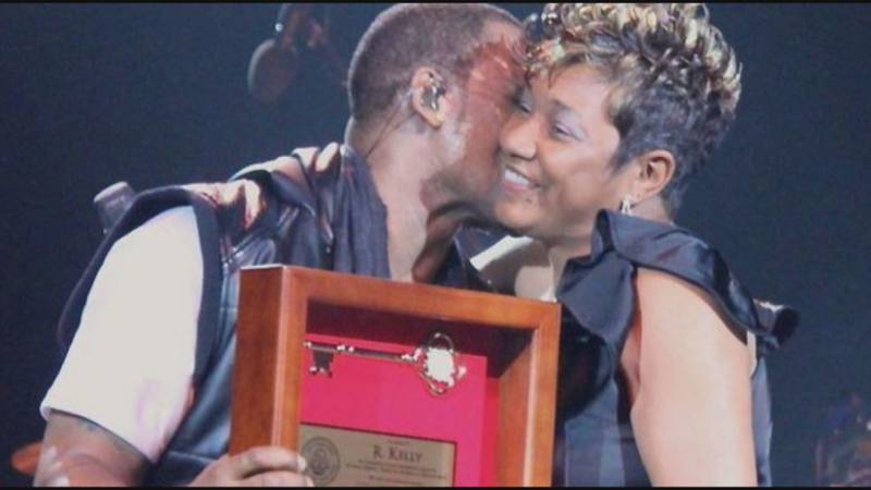 """FILE - C. Denise Marcelle, then an EBR Metro Council member, gives R. Kelly a """"key to the city""""..."""