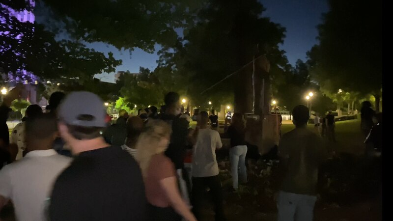 Protesters work to pull down statue of Charles LInn