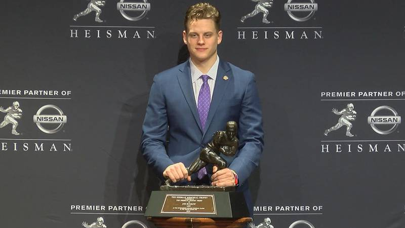 LSU quarterback Joe Burrow won the 85th Heisman Trophy, setting new records for the award in...