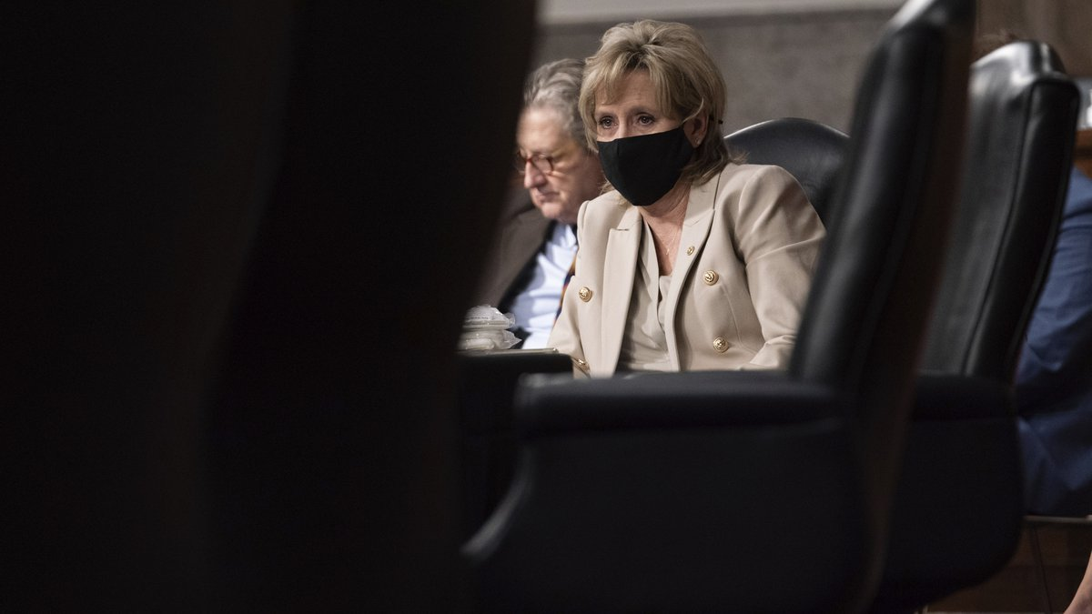 Sen. Cindy Hyde-Smith, R-Miss., listens at a hearing with the Senate Appropriations...