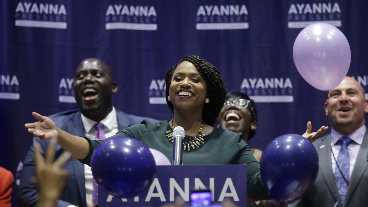 Boston City Councilor Ayanna Pressley, center, celebrates victory over U.S. Rep. Michael...