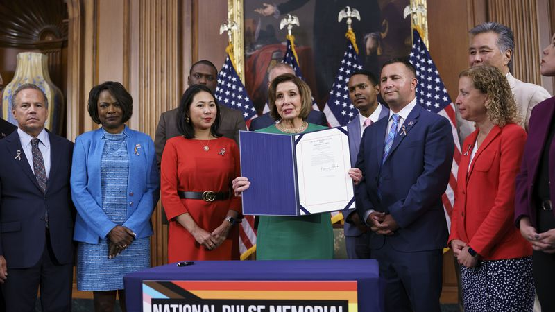 House Speaker Nancy Pelosi, D-Calif., is joined by members after signing a bill to create the...