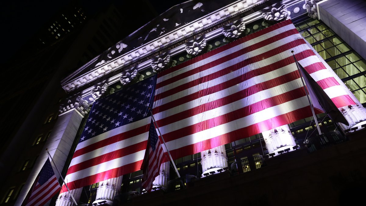 FILE- In this Feb. 17, 2017, file photo an American flag hangs on the front of the New York...