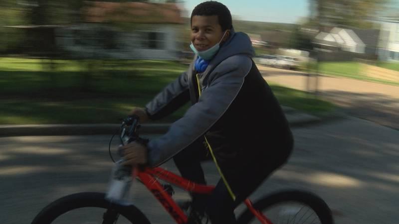 Kofi Louis rides his new bike thanks to the community's help