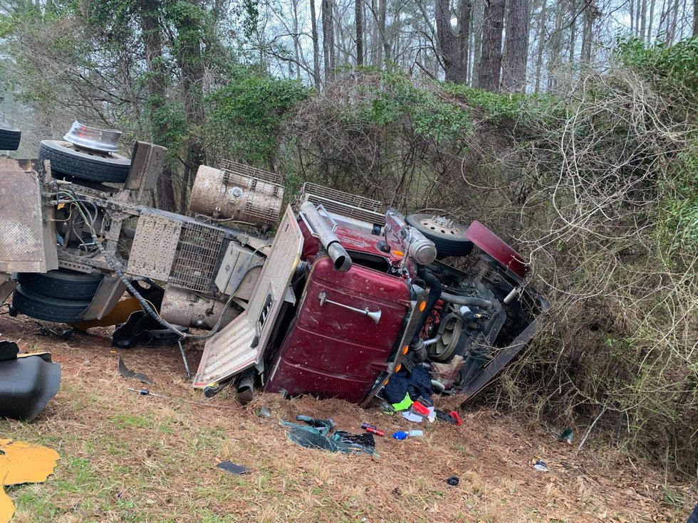 A log truck and a school bus were involved in the collision as it took place between Phillips...