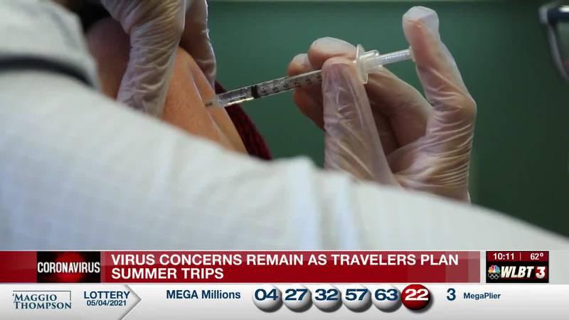 Virus concerns remain as travelers plan summer vacations