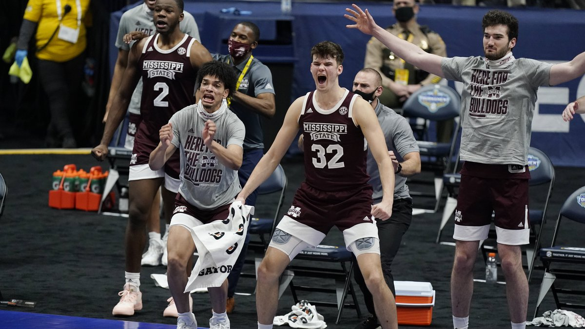 Mississippi State players celebrate on the bench after a score against Kentucky in the first...