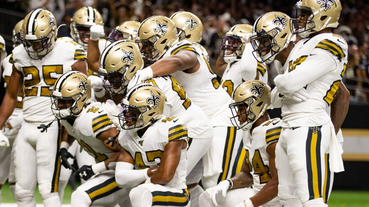 The Saints defense celebrates after a forced fumble by A.J. Klein, and recovery by Vonn Bell.