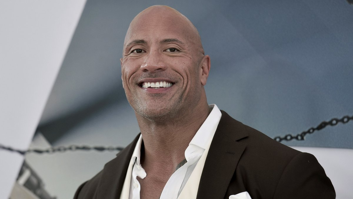 """FILE - Dwayne Johnson attends the premiere of """"Fast & Furious Presents: Hobbs & Shaw"""" on July..."""