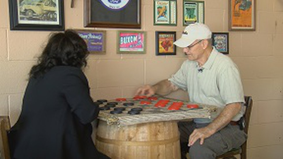 Tom Cook plays a game of checkers with Maggie Wade. (Source: WLBT)