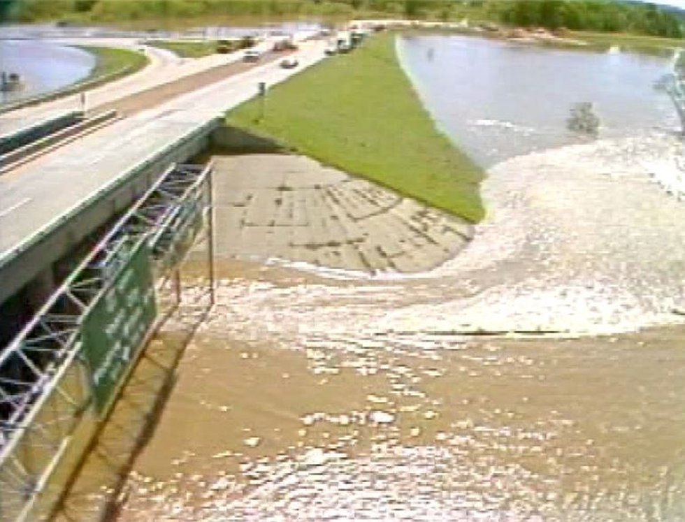 Flood water pours over I-55 under the Fortification Street bridge in the Easter Flood of 1979...