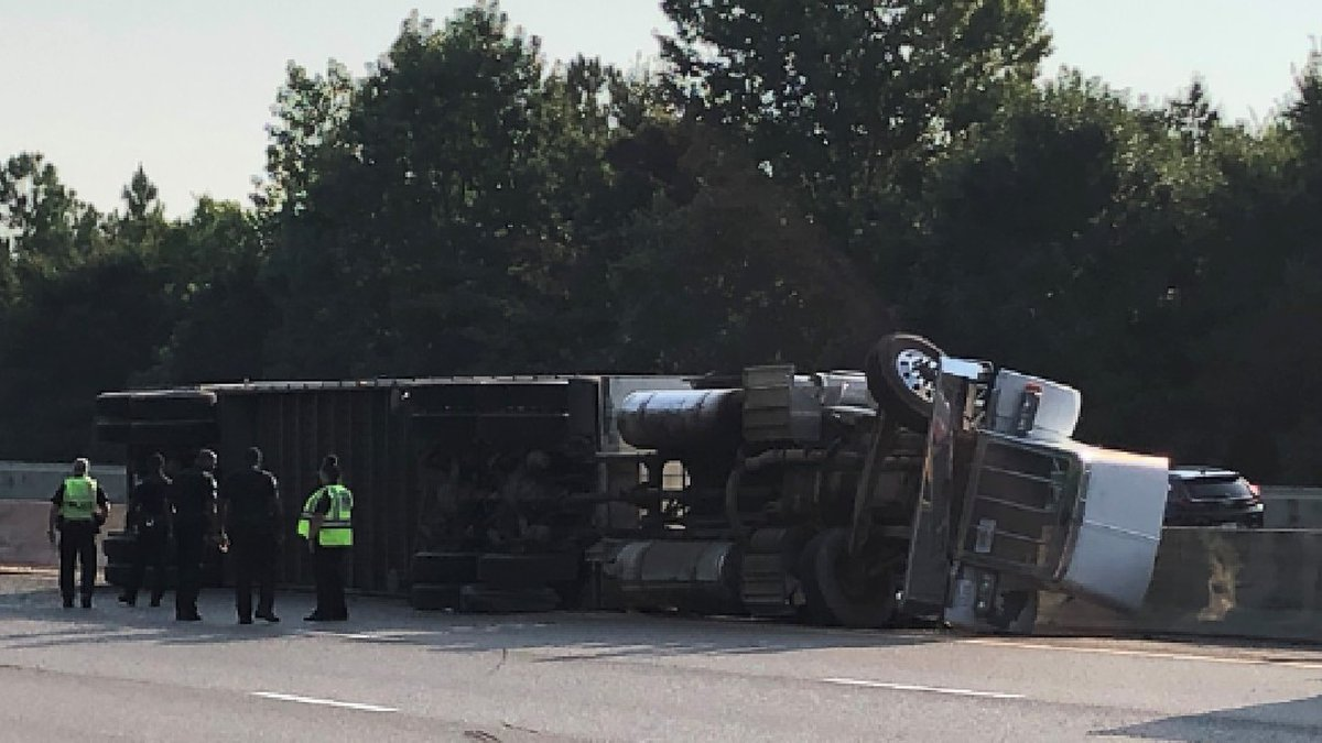 Two lanes closed after semi-truck overturns on I-55 before Fortification St.