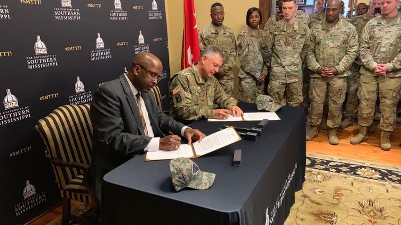 USM President Dr. Rodney Bennett and Maj. Gen. Janson D. Boyles, the adjutant general of...
