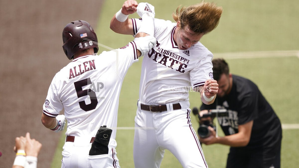 Mississippi State's Tanner Allen (5) congratulated by teammate Rowdey Jordan after hitting a...