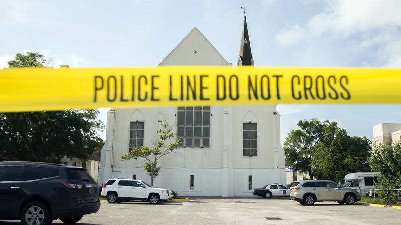 FILE - In this June 19, 2015 file photo, police tape surrounds the parking lot behind the AME...