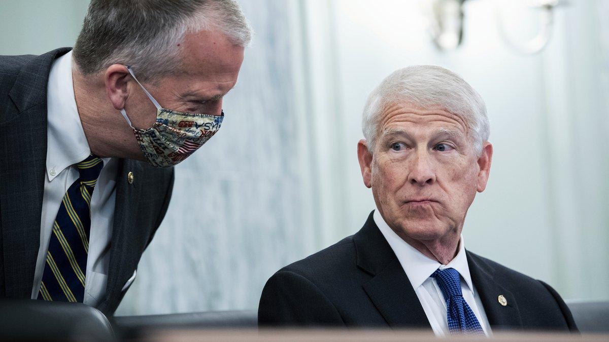 Chairman Roger Wicker, R-Miss., right, and Sen. Dan Sullivan, R-Alaska, confer during a Senate...