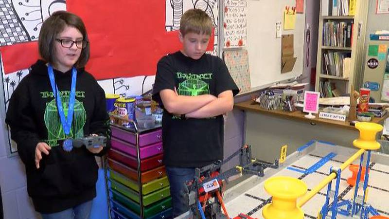 Fifth-grade students with their winning robot (Source: WLBT)