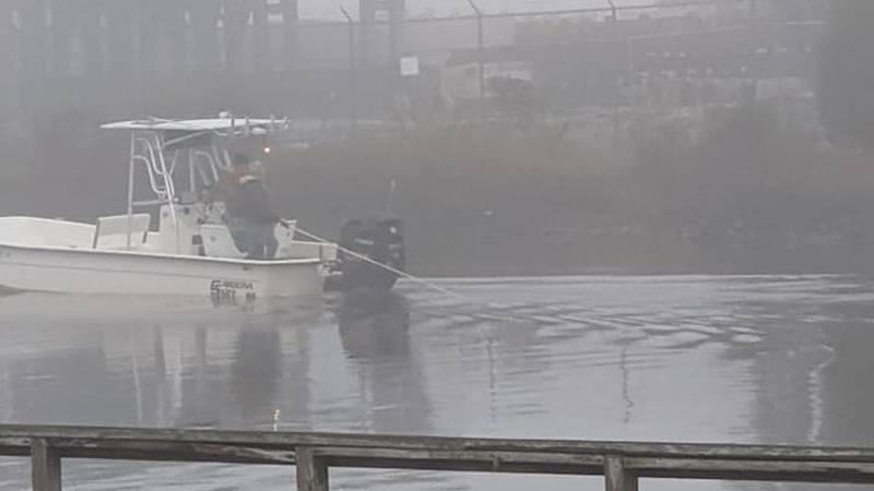 A boat searches Yazoo Bayou off The Point in Pascagoula Monday, looking for the body of a man...