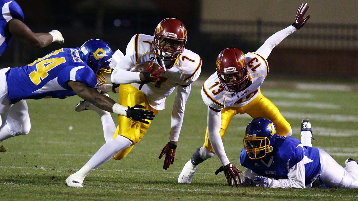 Laurel wide receiver Omar Bayless (7) lunges forward with a short pass reception as Oxford...