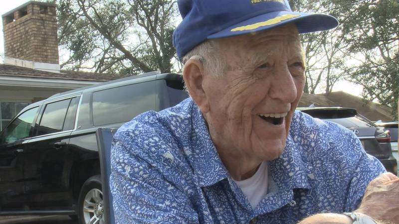 George Roberts of Gulfport laughed and told stories Sunday as friends and family hosted a...
