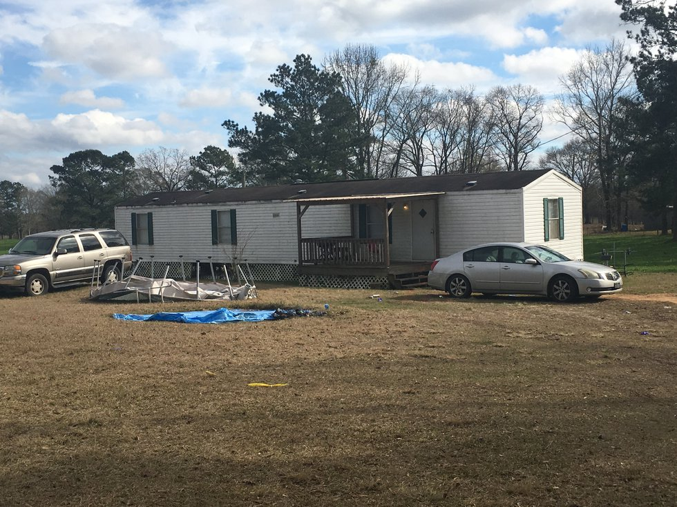Family members found Erica Hall with a knife still in her back beside her car outside her...
